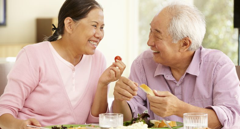Senior asian couple eating healthy food