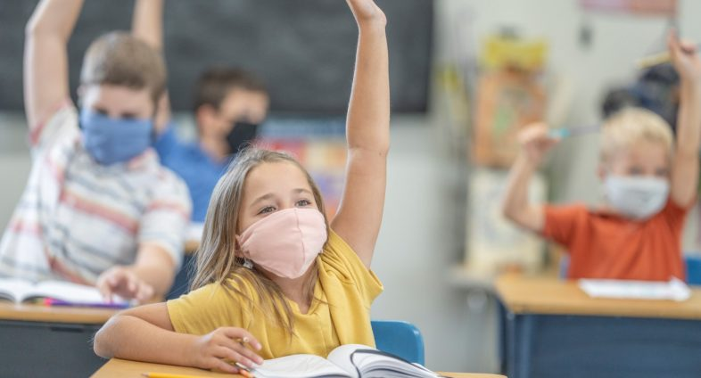 elementary students in class wearing face masks